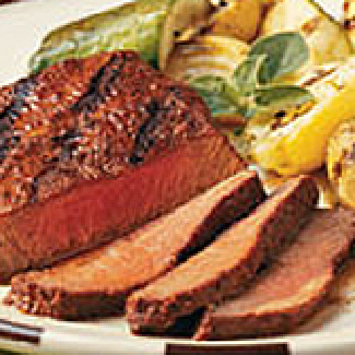 Flat Iron Steaks with Grilled Corn and Cumin-Lime Butter